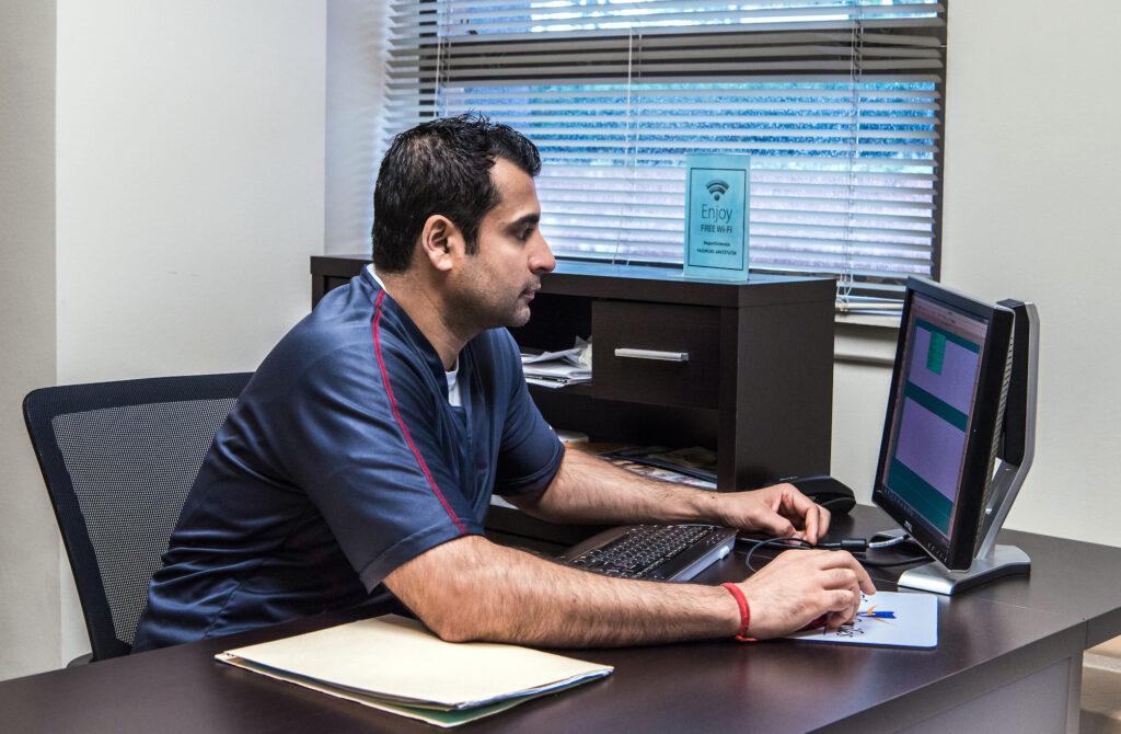 dr-kumra-at-desk